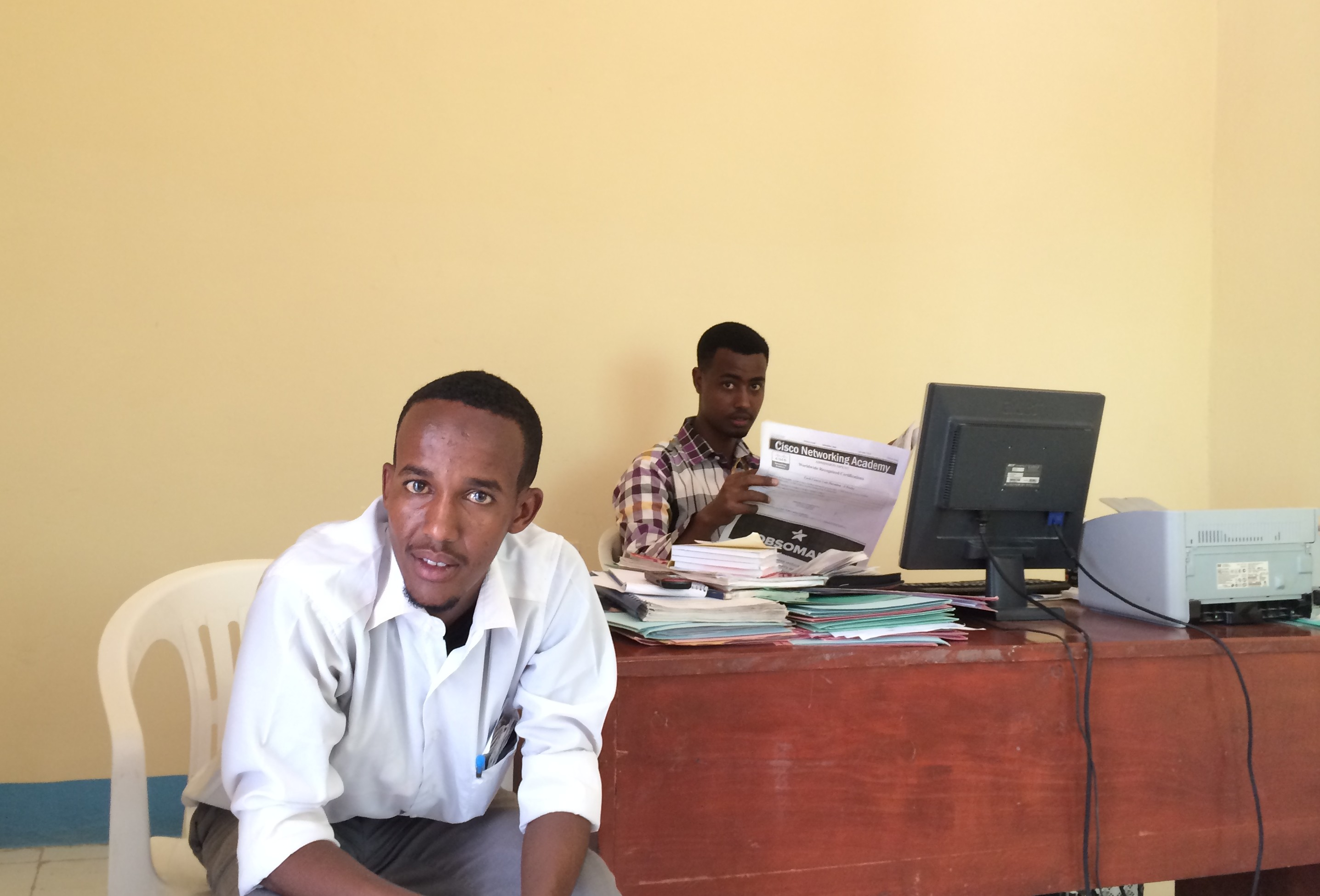 Bukhaari, a lawyer who graduated in the first graduating class and Mohamed, who got a degree in IT at PSU, working at the  PLAC office in Garowe.